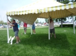 The tent starts to go up at Crescent for the picnic (photo courtesy Nancy LeRoy Burk)
