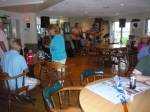The party moved inside clubhouse when the rain came (photo courtesy Nancy LeRoy Burk)