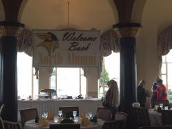 Carol Appleton Holloway looking at the Alumni Banner in our reception room at the Grosse Pointe Yacht Club.  Background: